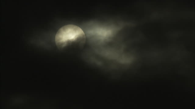 dark clouds rush past a full moon. - moon stock videos & royalty-free footage