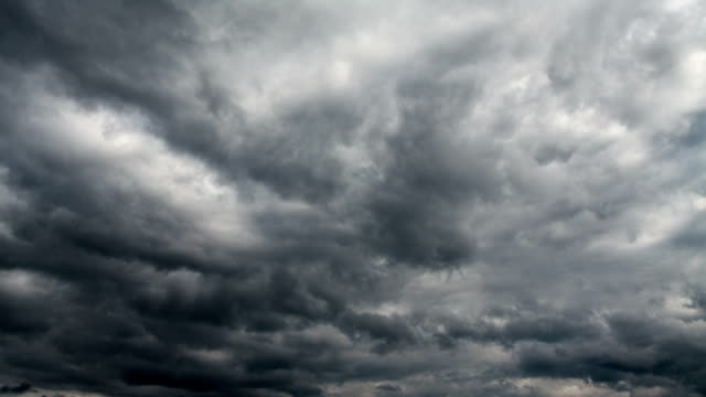 time lapse: dark clouds - dramatic sky stock videos & royalty-free footage