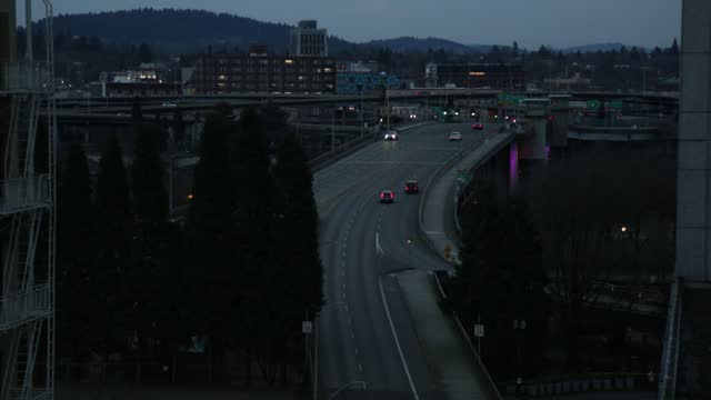 dark downtown city street and traffic - portland oregon stock videos & royalty-free footage