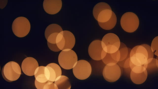 dark gold reflections and bokeh - rich defocused light leak effect - light leak stock videos & royalty-free footage