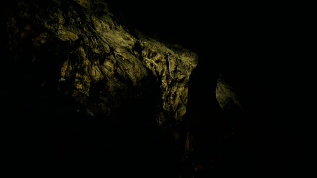 dark golden cave - cave stock videos & royalty-free footage