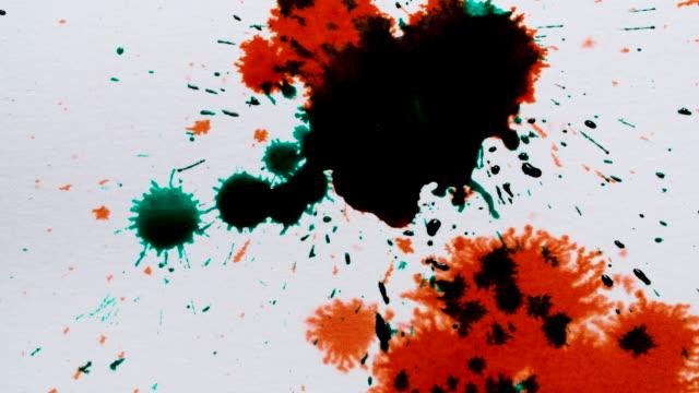 dark green ink droplets splash onto red ink - ideas stock videos & royalty-free footage