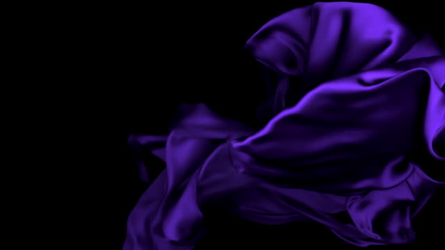 vídeos de stock e filmes b-roll de dark metallic purple silky fabric flowing and waving horizontally in super slow motion and close up, black background - purple
