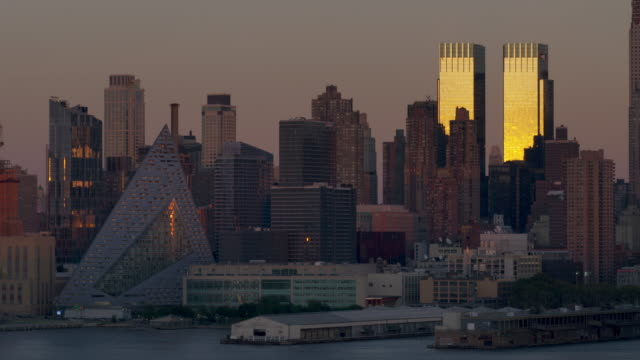 dark midtown skyline at dusk with the time warner building last light of day - time warner center stock videos & royalty-free footage