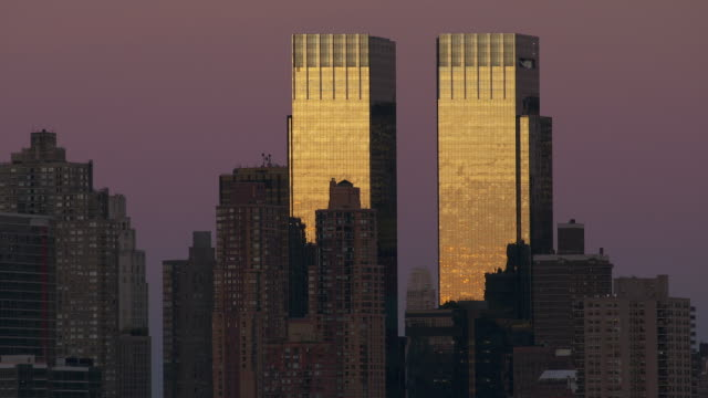 dark midtown skyline at dusk with time warner building last light of day - time warner center stock videos & royalty-free footage