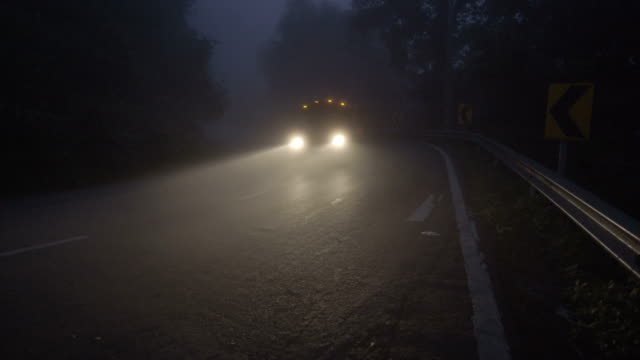 4k ws, dark misty curve road with truck at early morning. - pick up truck stock videos and b-roll footage