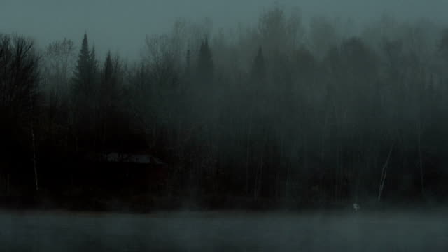 dark misty lake loop - log cabin stock videos & royalty-free footage
