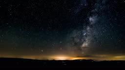 Dark night starry sky with stars and milky way galaxy over nature landscape Astronomy Time lapse
