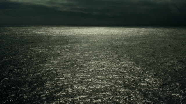 dark seascape with clouds over north pacific ocean - north pacific stock videos & royalty-free footage