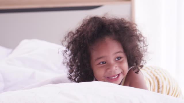 dark skin child run and fun - sheet bedding stock videos & royalty-free footage