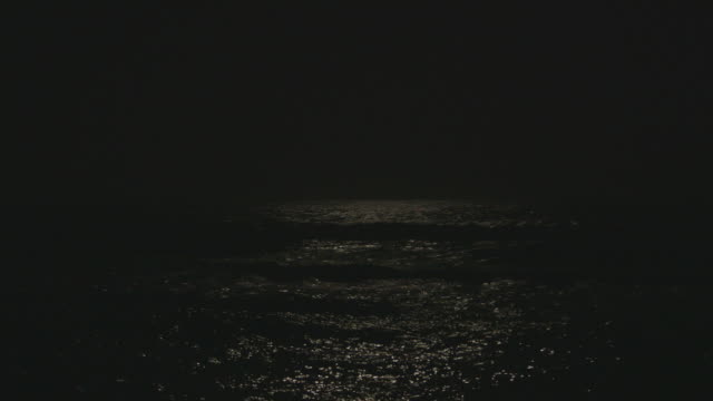 ws dark sky meets ocean reflecting moonlight - seascape stock videos & royalty-free footage
