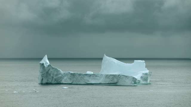 Dark Sky Over Iceberg In The Arctic