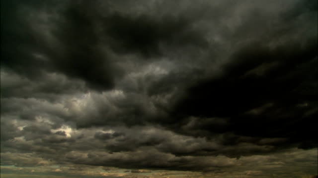 dark storm clouds gather above new york city. - ominous stock videos & royalty-free footage