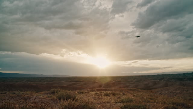 dark storm clouds roll across a high desert landscape in western colorado at sunset - swaying stock videos & royalty-free footage