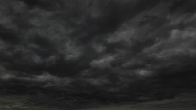 dark storm clouds - moving past stock videos & royalty-free footage