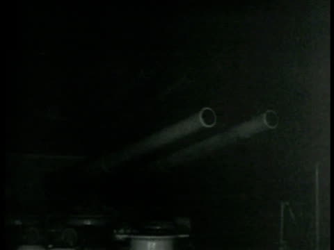dark water. us sailor using binoculars. water. artillery on ship. explosions weapons being fired at night flashes of artillery near far. ship on... - artillery stock videos & royalty-free footage