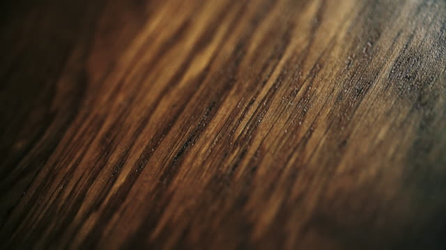 dark wood texture close-up. dolly shot - wooden floor stock videos & royalty-free footage