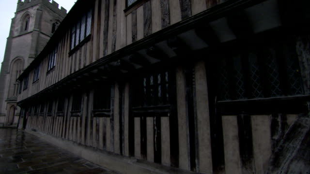 Dark wooden slats decorate the exterior of a Tudor building. Available in HD.