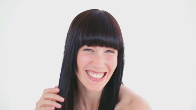 darkhaired woman holding a strand of her hair - bangs stock videos and b-roll footage