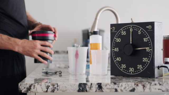 darkroom timer in a home kitchen - film container stock videos & royalty-free footage
