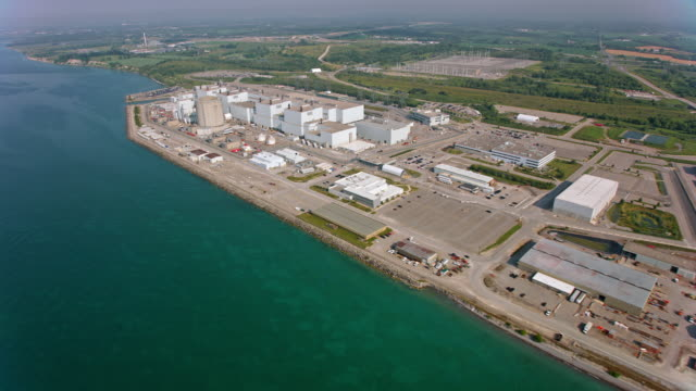 aerial darlington nuclear generating station on the shore of lake ontario - nuclear energy stock videos & royalty-free footage