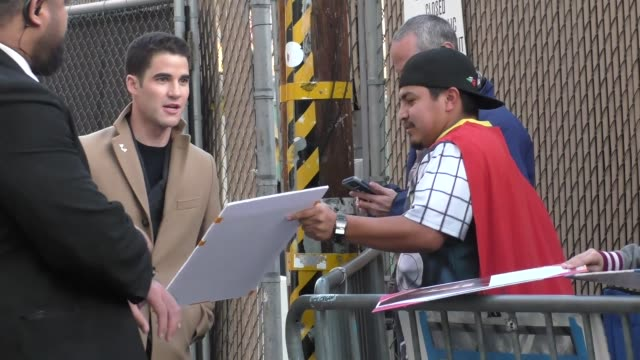 Darren Criss signs autographs for fans outside Jimmy Kimmel Live at El Capitan Theater in Hollywood in Celebrity Sightings in Los Angeles