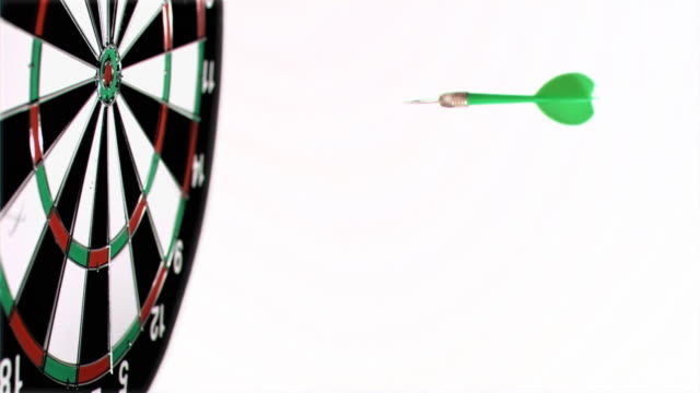 dart being thrown in super slow motion on a dart board - dart board stock videos & royalty-free footage