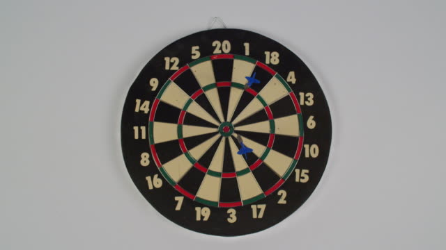 dart board is hit by two darts. - dart board stock videos & royalty-free footage