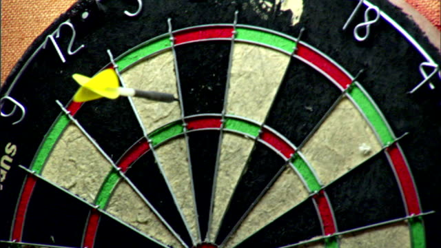 cu dart board on wall dart sticking into 5 white second into 20 black third into 5 white tavern games social competition interaction skill - dart board stock videos & royalty-free footage