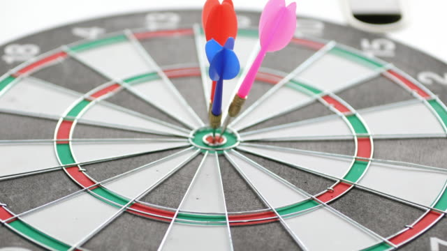 dart hits bullseye - dart board stock videos & royalty-free footage