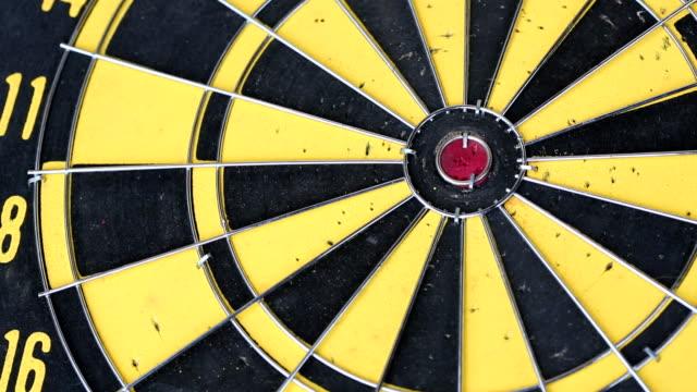 dart hitting bull's eye - bull's eye stock videos and b-roll footage