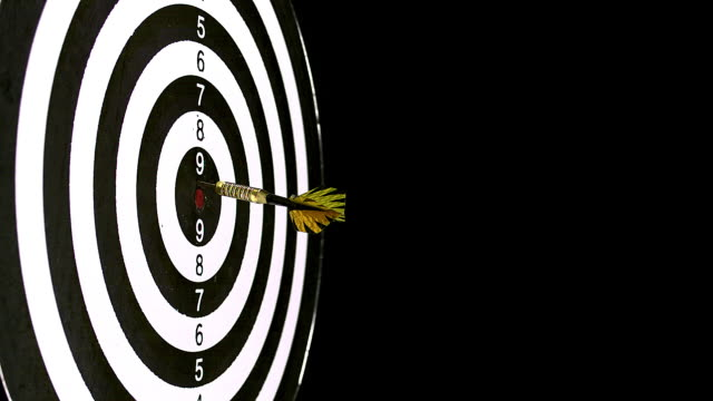 """""""dart hitting dartboard against black background, slow motion"""" - bull's eye stock videos and b-roll footage"""