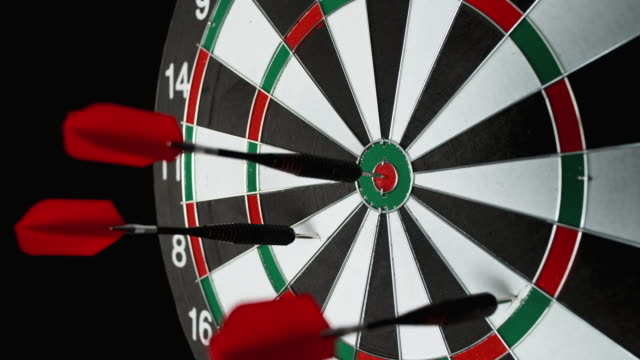 slo mo dart hitting inner bull of the board - dart board stock videos & royalty-free footage