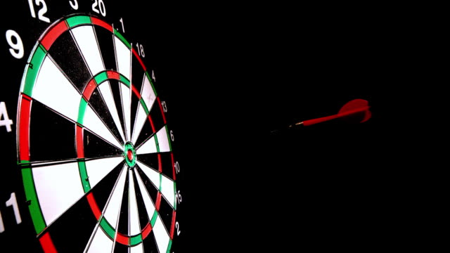 dart hitting the bulls eye side view - dart board stock videos & royalty-free footage