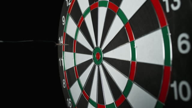 slo mo dart hitting the inner bull - dart board stock videos & royalty-free footage