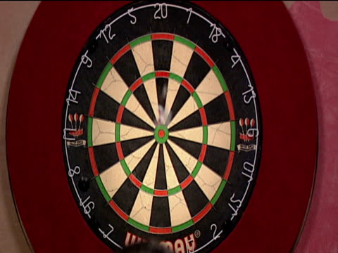 dart is thrown at board and bounces off 2003 embassy world darts championships lakeside frimley green - dart board stock videos & royalty-free footage