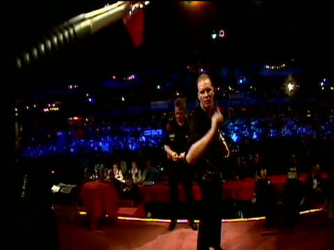 Dartboard camera on Vincent van der Voort throwing darts celebrates with a thrust of the fist 2003 Embassy World Darts Championships Lakeside Frimley...