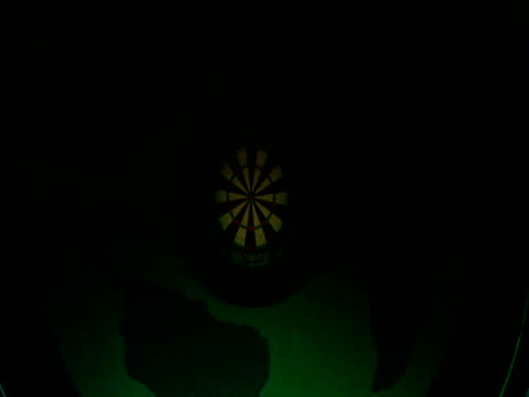 Dartboard glowing in green and blue light 2003 Embassy World Darts Championships Frimley Green Lakeside