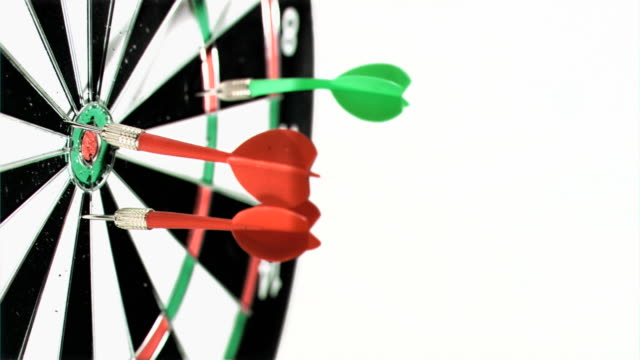 darts being thrown in super slow motion on a dart board - medium group of objects stock videos & royalty-free footage