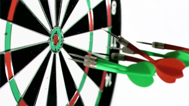 darts grouped together in super slow motion being thrown on a dart board - dart board stock videos & royalty-free footage