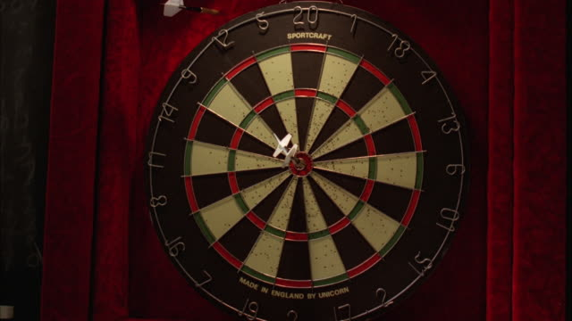 MS Darts hit wall near bull's eye at dart board