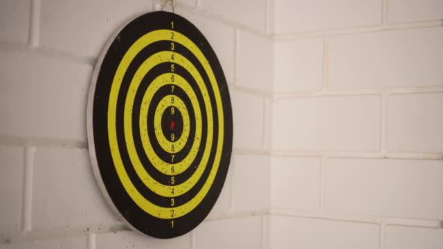 darts hitting dart board . - game show stock videos & royalty-free footage