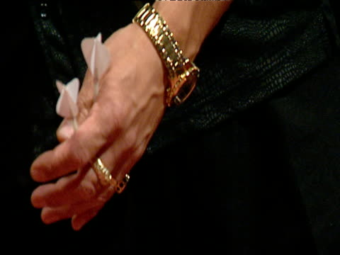 darts players' hand adorned with gold rings and gold watch as he holds spare darts, lakeside, frimley green - intricacy stock videos & royalty-free footage