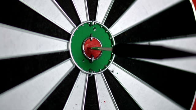 slo mo darts point hitting the inner bull - dart board stock videos & royalty-free footage