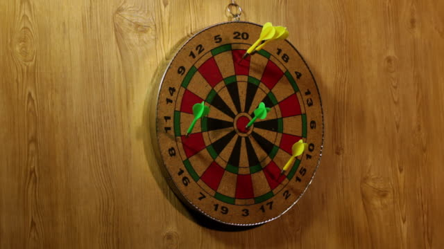 Darts striking on a dartboard