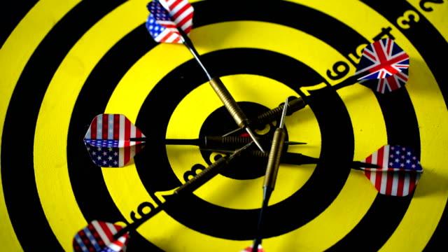 cu darts striking target bull's-eye - bull's eye stock videos and b-roll footage