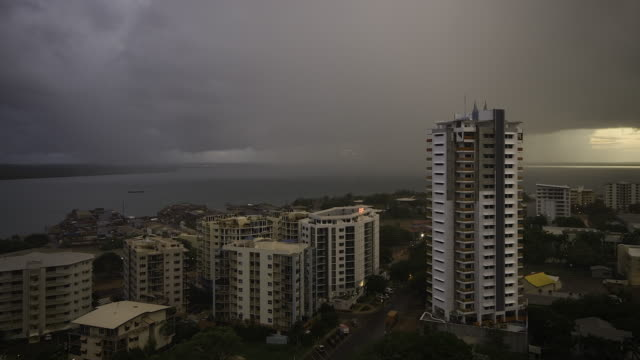 4k darwin high-rise buildings, harbour and storm clouds, top end, nt - weather stock videos & royalty-free footage