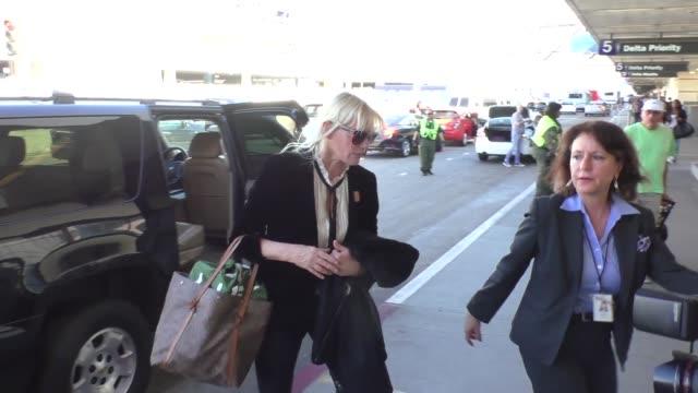 daryl hannah departing at lax airport in los angeles in celebrity sightings in los angeles - daryl hannah stock videos & royalty-free footage