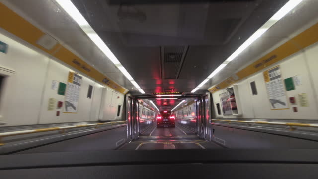 dashboard camera point of view driving inside a channel tunnel train carriage, folkestone, united kingdom - compartment stock videos & royalty-free footage