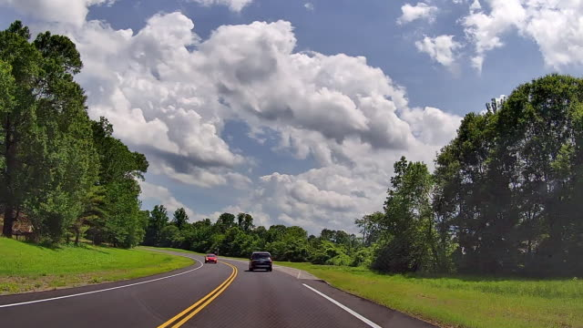 dashboard camera point of view of clouds and highway traffic in tennessee, usa - romantic sky stock videos & royalty-free footage